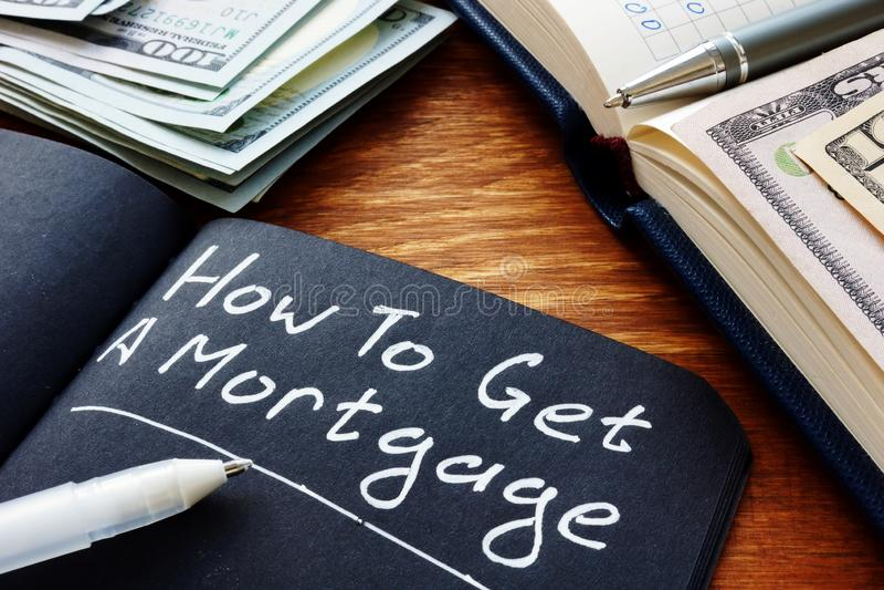 Hoe krijg je een hypotheekvraag geschreven in de notitieblok? stock foto's