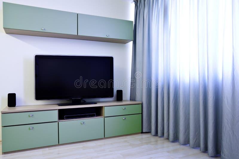 Hoek in moderne ruimte met TV royalty-vrije stock foto