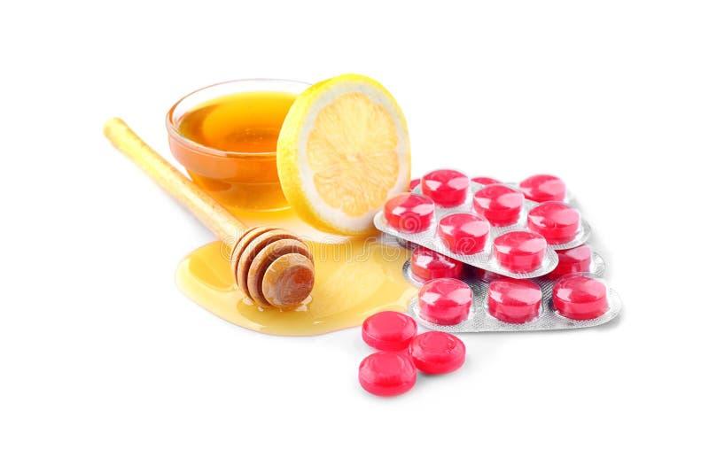 Hoestdalingen met honing en citroen stock foto