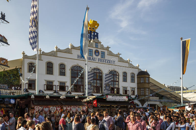 Hofbraeu tent at Oktoberfest in Munich, Germany, 2016. Munich, Germany - September 24, 2016: Facade and entrance of the Hofbraeu beer tent with unidentified stock photos