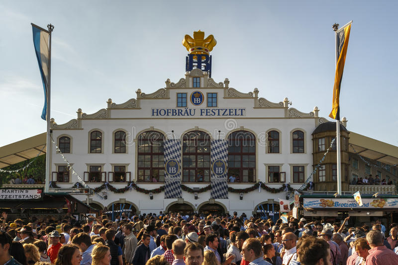 Hofbraeu tent at Oktoberfest in Munich, Germany, 2016. Munich, Germany - September 24, 2016: Facade and entrance of the Hofbraeu beer tent with unidentified royalty free stock images