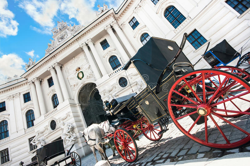 Hofburg Palace with traditional Fiaker carriage in Vienna, Austria stock photo