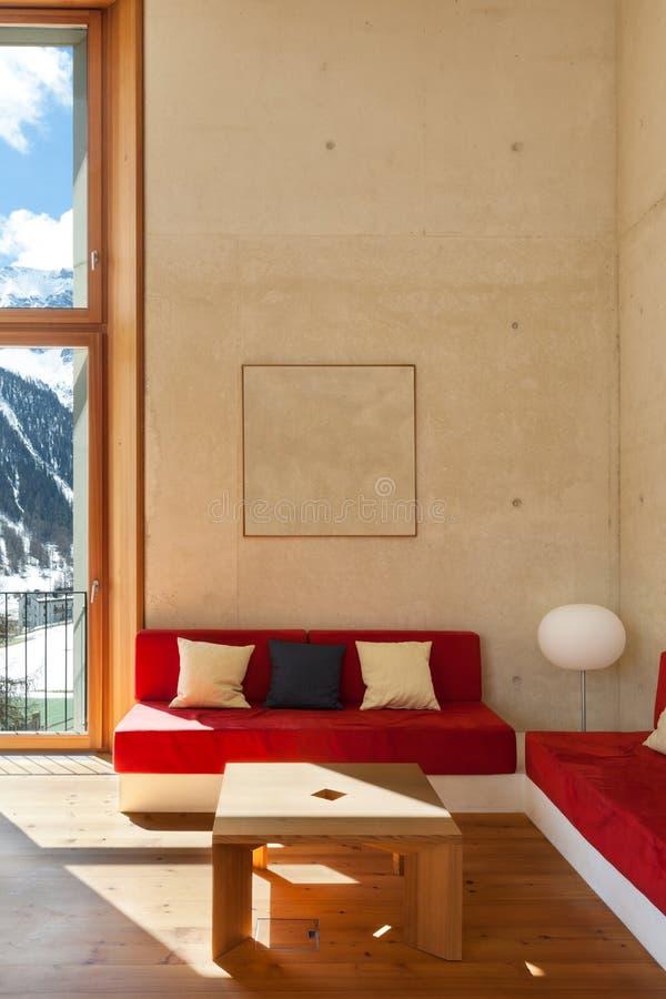 Hogar de la montaña, sala de estar foto de archivo libre de regalías