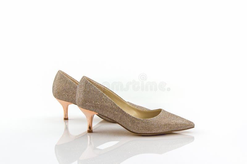 Hoge hiel van gouden schoenen royalty-vrije stock afbeeldingen