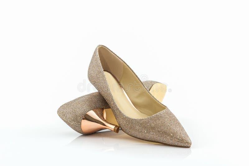 Hoge hiel van gouden schoenen stock foto's
