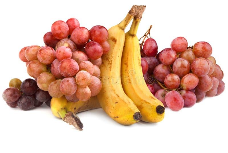 Hoge resolutiefoto van rode druiven en bananen stock foto's