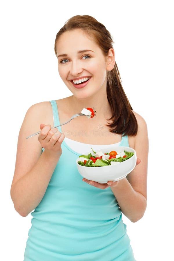 Hoge zeer belangrijke Portret jonge Kaukasische vrouw die salade geïsoleerd o eten stock foto