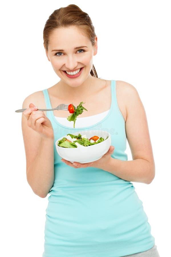 Hoge zeer belangrijke Portret jonge Kaukasische vrouw die salade geïsoleerd o eten royalty-vrije stock foto