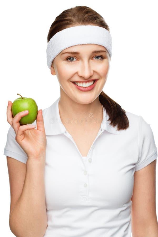 Hoge zeer belangrijke Portret jonge vrouw die groene appel houden die op wh wordt geïsoleerd stock foto's