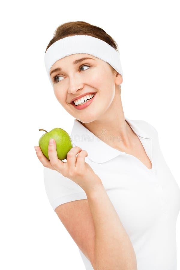 Hoge zeer belangrijke Portret jonge vrouw die groene appel houden die op wh wordt geïsoleerd royalty-vrije stock afbeeldingen
