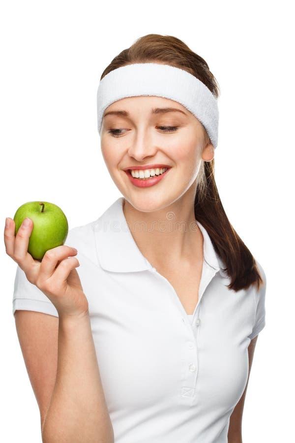 Hoge zeer belangrijke Portret jonge vrouw die groene appel houdt die op wh wordt geïsoleerd royalty-vrije stock afbeelding