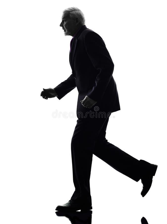 Hoger bedrijfsmensen lopend silhouet stock fotografie