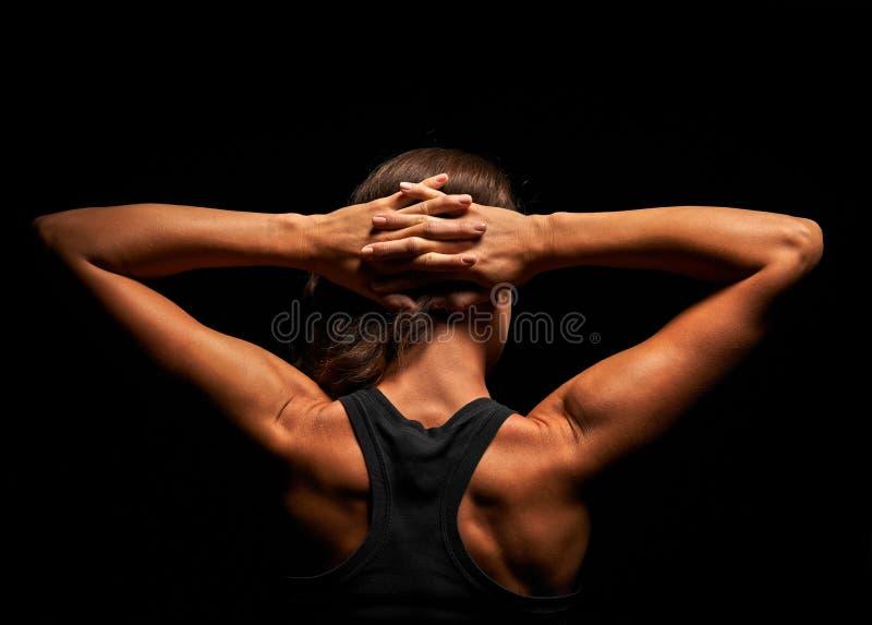 Hoger lichaam van een spiervrouw van de rug stock afbeeldingen