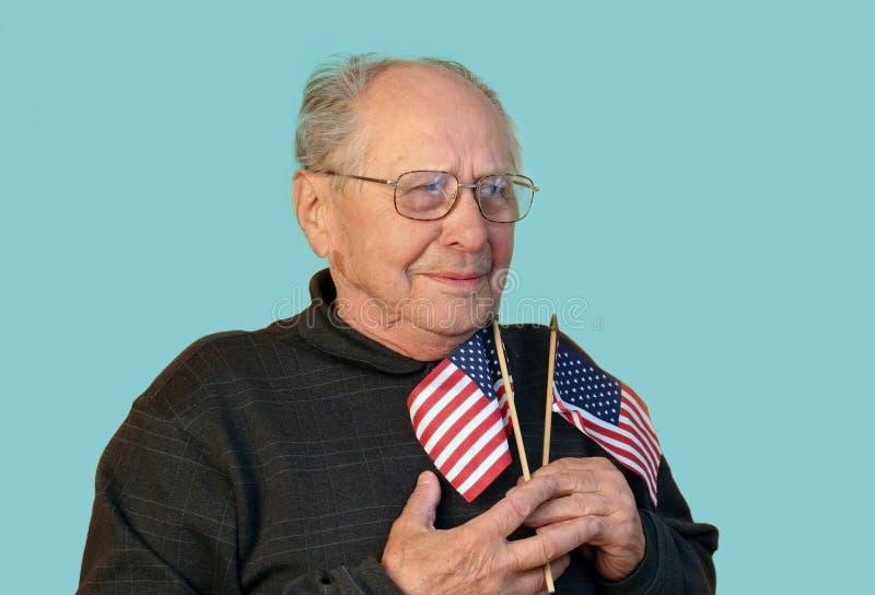 Hogere geïsoleerded mens met Amerikaanse vlag royalty-vrije stock afbeelding