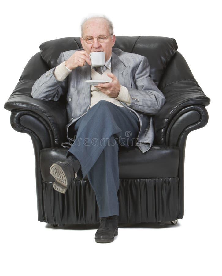 Hogere het drinken koffie stock afbeelding