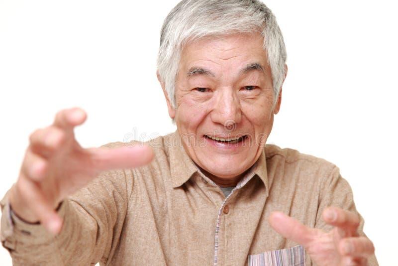 Hogere Japanse mens met bovennatuurlijke macht royalty-vrije stock foto