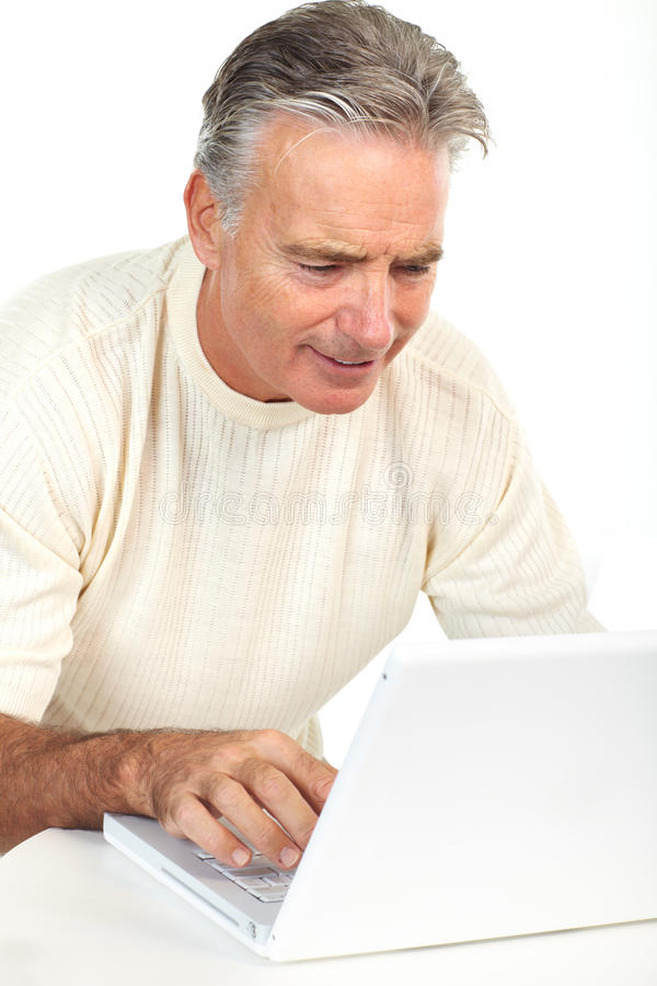 Hogere mens met laptop stock afbeeldingen
