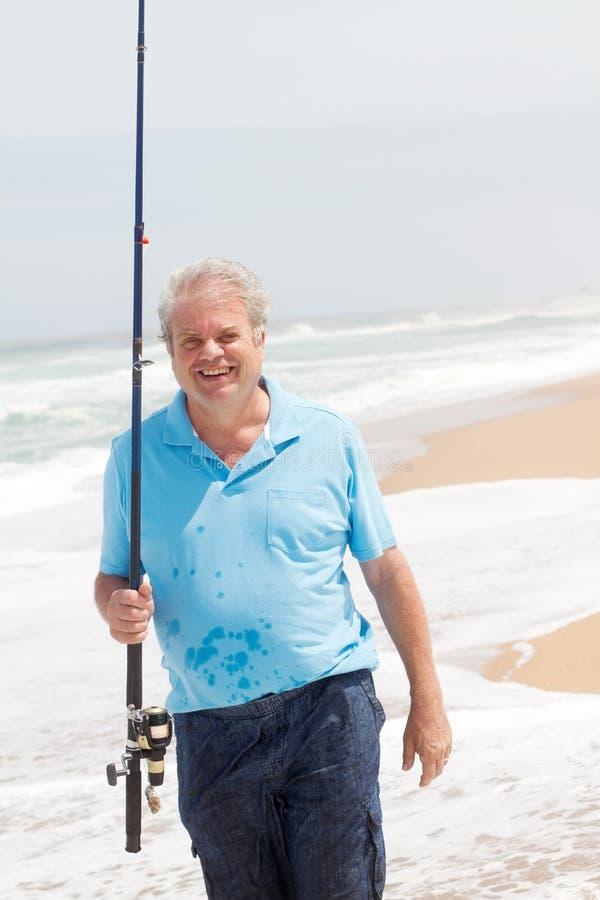 Hogere mens visserij stock foto