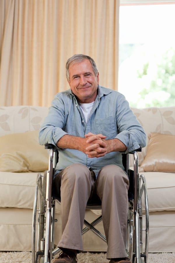 Hogere mens in zijn rolstoel royalty-vrije stock afbeeldingen