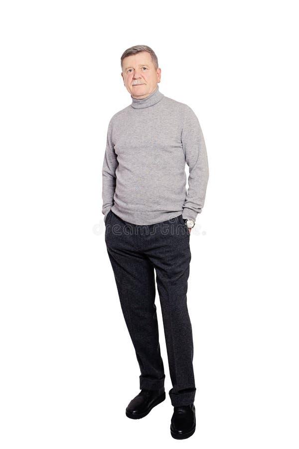 Hogere Mensenzakenman die Broodjeshals Jumper In Grey Isolated dragen stock foto's
