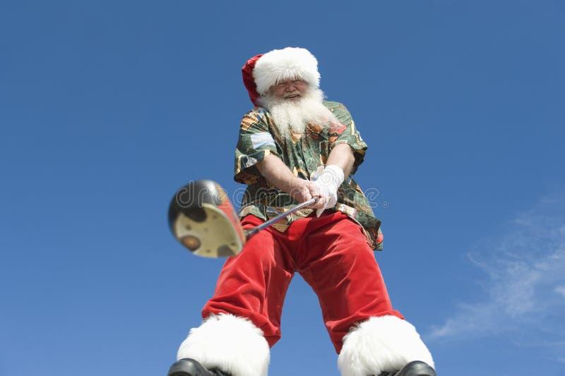 Hogere Santa Claus Holding Golf Club stock afbeelding