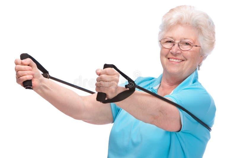 Hogere vrouw bij gymnastiek stock foto