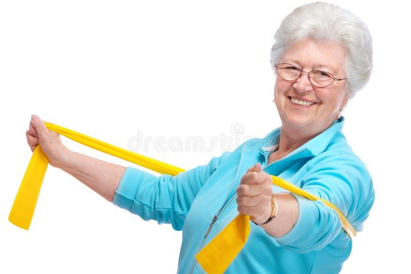 Hogere vrouw bij gymnastiek stock fotografie