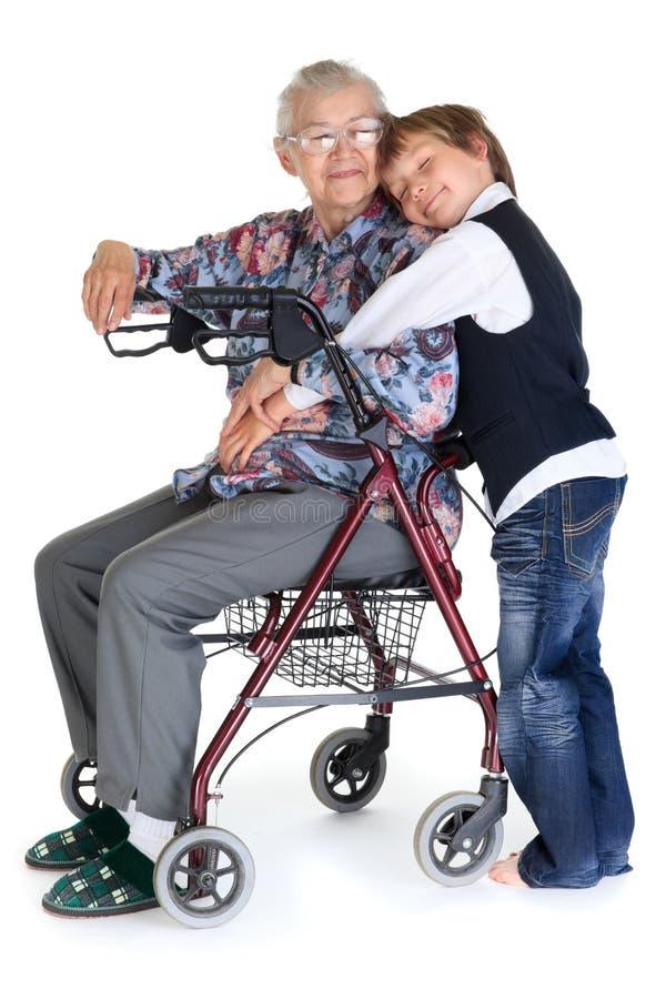 Hogere vrouw en kleinzoon stock fotografie