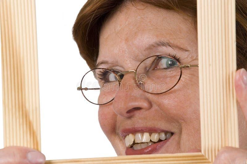 Hogere vrouw in frame 2 royalty-vrije stock afbeeldingen