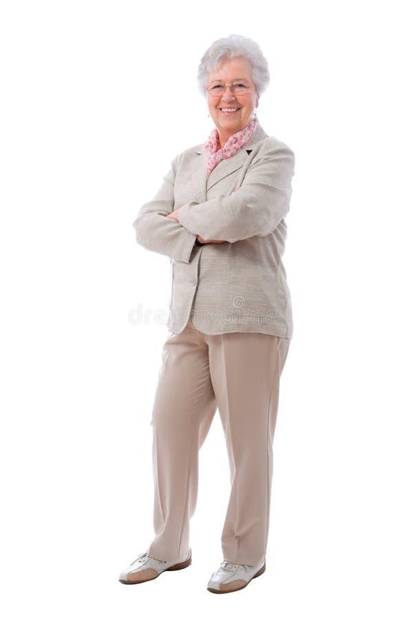 Hogere vrouw status stock foto