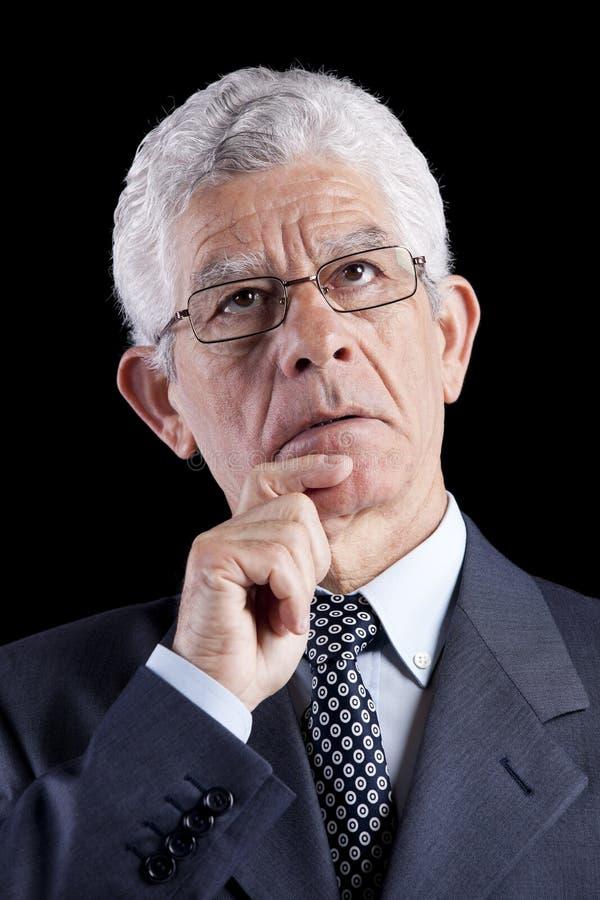 Hogere zakenman die omhoog kijkt royalty-vrije stock afbeelding