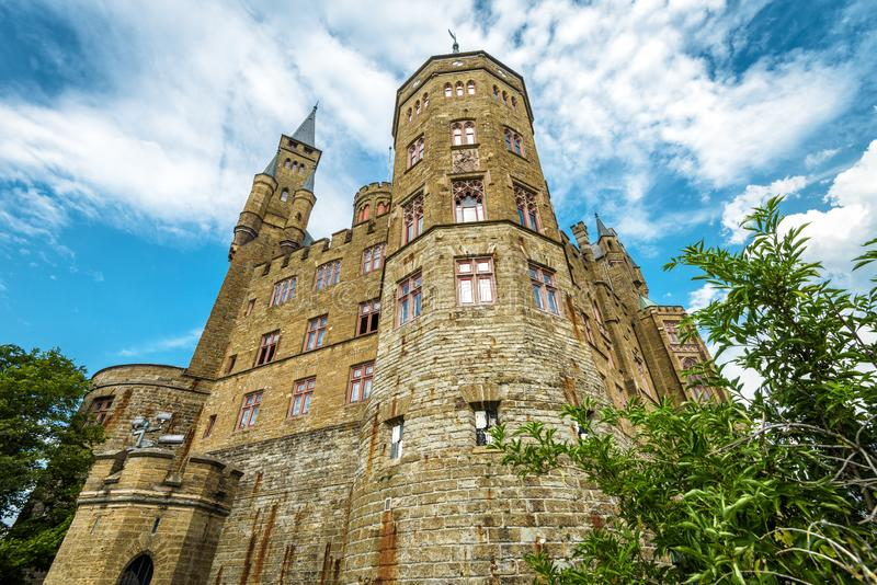 Hohenzollern Castle close-up, Germany. This castle is a landmark in Stuttgart vicinity. Bottom view of strong majestic Hohenzollern towers in summer. Famous royalty free stock photography