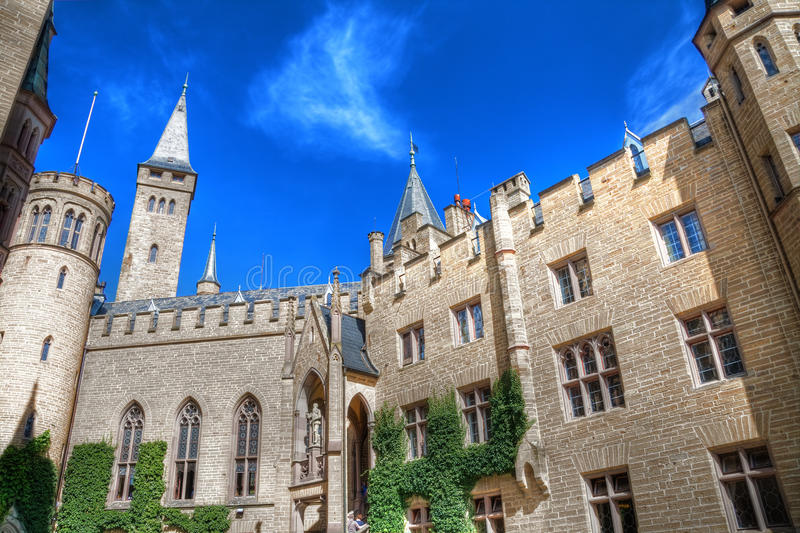 Hohenzollern castle HDR. Hohenzollern castle inner courtyard in HDR with clear blue sky in the background stock image