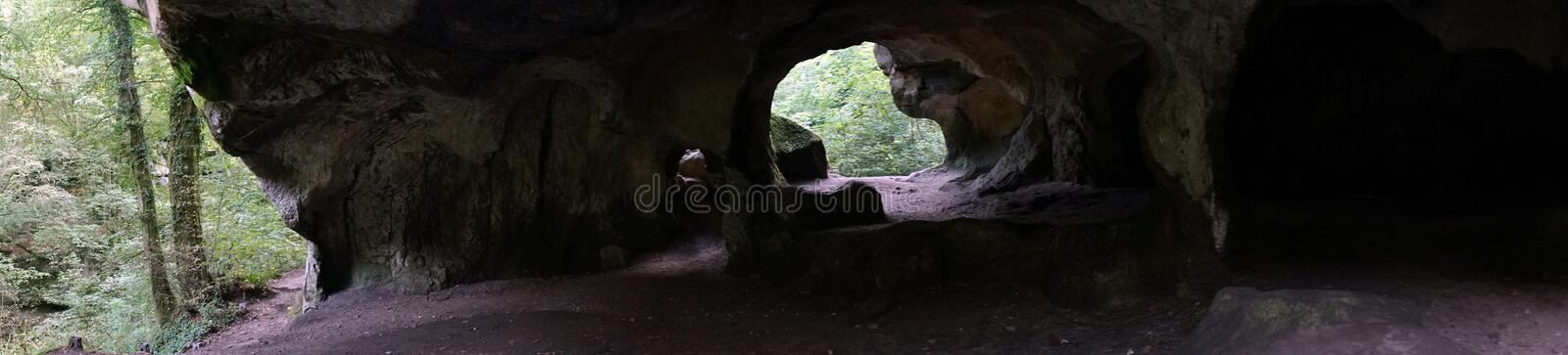 Hohhlay cave and forest. Hohllay cave in the forest in Luxembourg royalty free stock photography