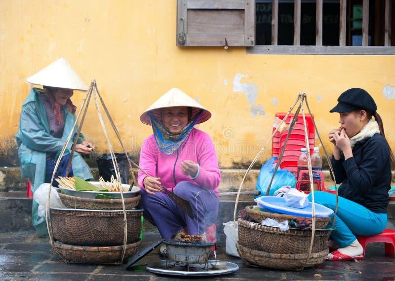 Hoi An street sellers. HOI AN, VIETNAM - DECEMBER 20, 2011: Unidentified Vietnamese street sellers in Hoi An, december 20, 2011 in Vietnam stock images