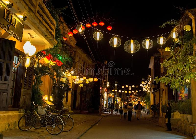 Hoi An Lanterns. Hoi An, Vietnam - December 20th 2017. Colourful yellow, red and white fabric lanterns hang across a street in the historic UNESCO listed royalty free stock photo