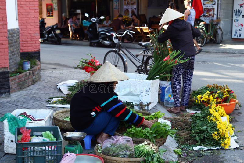 Local Vietnamese woman on a street market. stock photography
