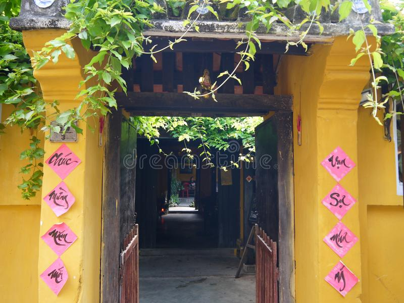Hoi An, Vietnam - MARCH 18, 2018: Beautiful vintage old style gate of a coffee shop stock photos