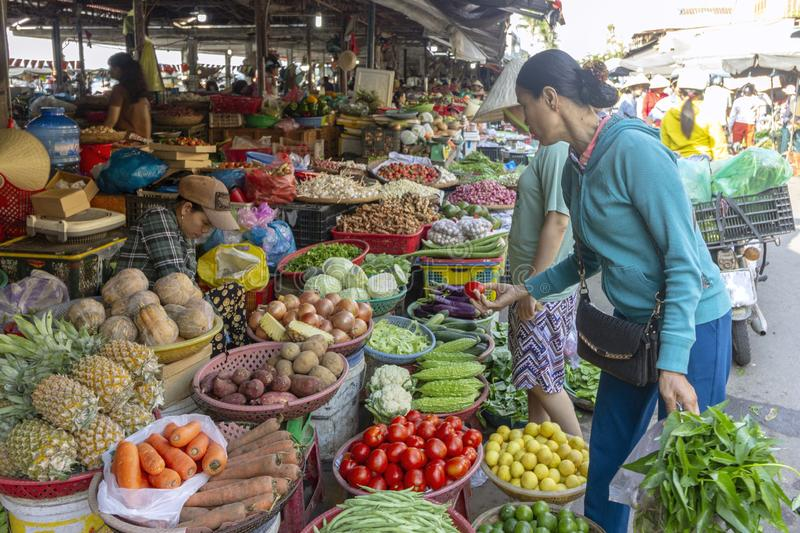 Hoi An, Vietnam - October 30, 2018: People in local fresh food market stock photos
