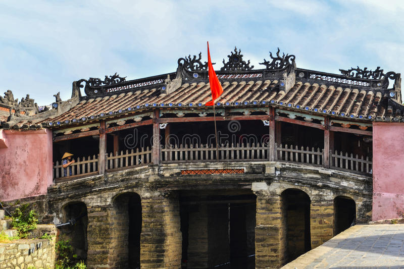 Hoi An, Vietnam - September 02, 2013 - The woman is standing at the Japanese covered bridge royalty free stock photos