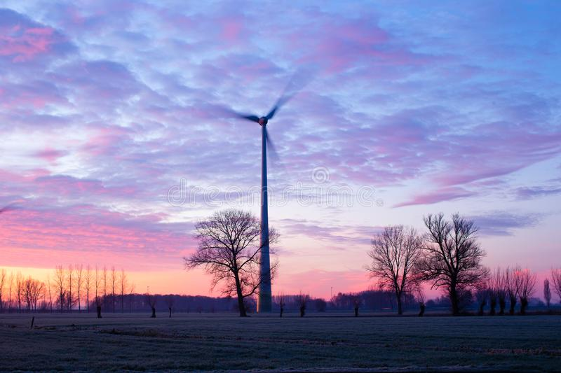 Single windmill in winter stock images