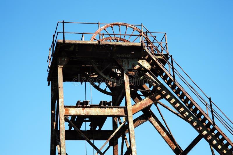 Hoist wheel at a coal mine. Hoist wheel used at a coal mine shaft royalty free stock image