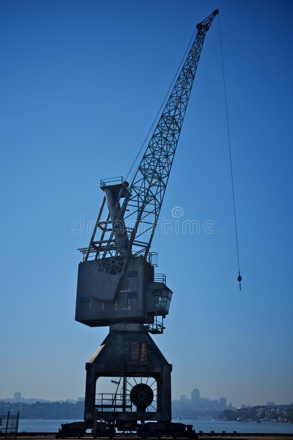 Hoisting crain. With a blue sky in the background stock photos