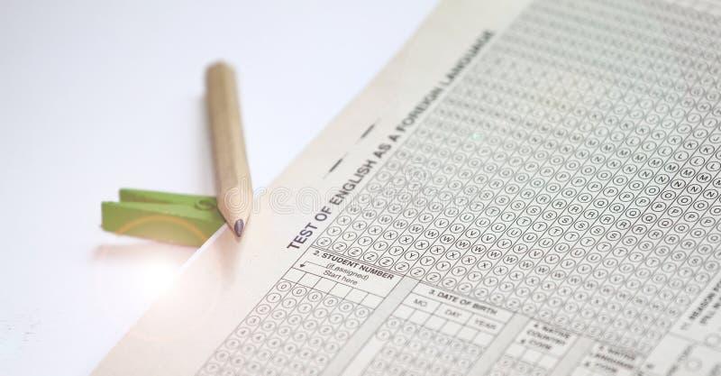 Hoja de respuesta de la prueba de inglés como idioma extranjero, hojas de prueba de TOEFL Examen de TOEFL Preguntas de la práctic foto de archivo