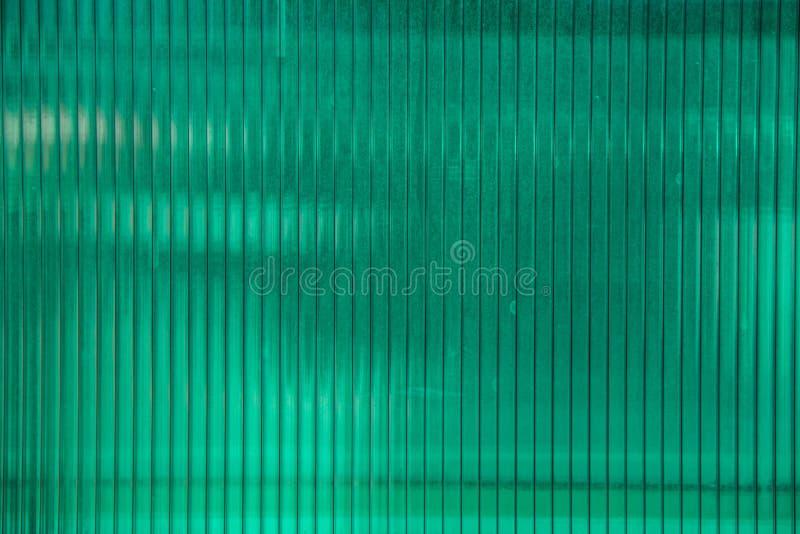Hoja plástica verde del material del policarbonato foto de archivo libre de regalías