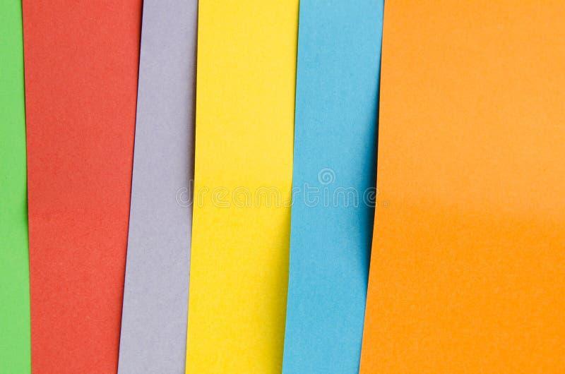 Hojas coloridas del papel del color, fondo abstracto foto de archivo libre de regalías