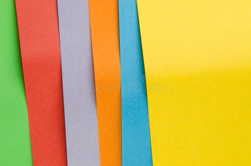 Hojas coloridas del papel del color, fondo abstracto imágenes de archivo libres de regalías
