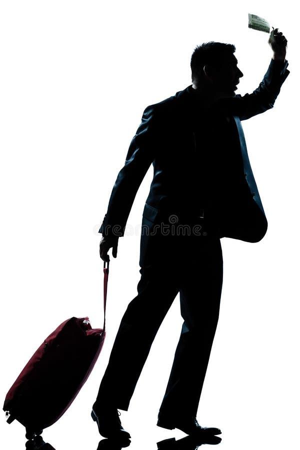 Hojas de ruta (traveler) de asunto del hombre de la silueta que se apresuran tarde imagenes de archivo