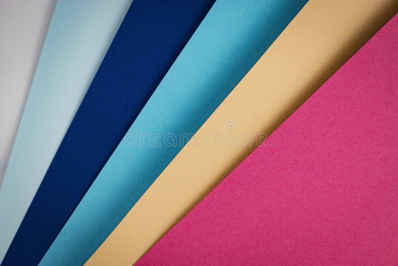 Hojas del papel coloreado fotos de archivo libres de regalías