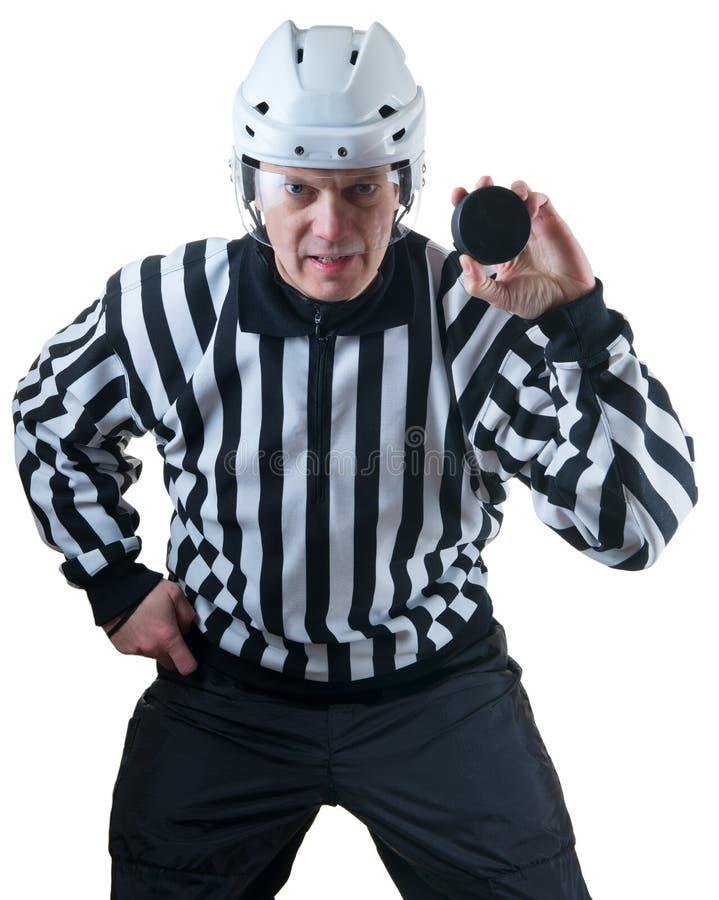 Hokejowy arbiter z krążkiem hokojowym obraz stock